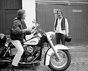 George and Chris with a Harley Davidson on Jefferies Street in Camden, London, UK, 1980s.