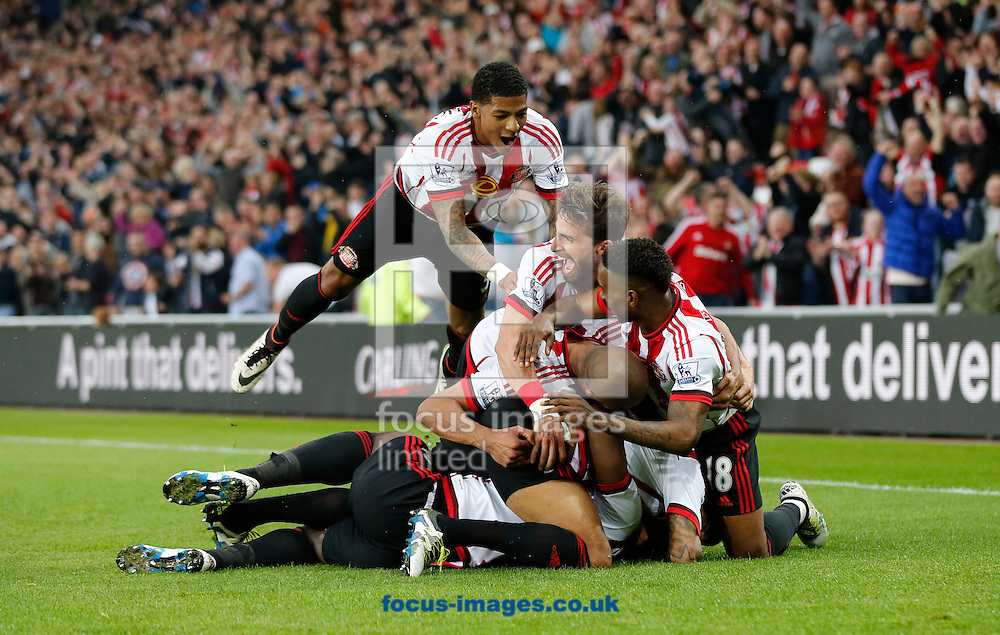 Sunderland celebrate scoring to make it 2-0  during the Barclays Premier League match at the Stadium Of Light, Sunderland<br /> Picture by Simon Moore/Focus Images Ltd 07807 671782<br /> 11/05/2016