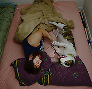 Vinnie, a 5-year-old pitbull from the East Tennessee Pitbull Rescue, wakes his owner, Codie Kriehn, with early morning rough housing in their Newport News, Virginia home Oct. 1, 2016. The pair sleeps together every night.