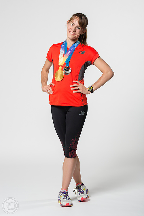 Jenny Barringer Simpson poses with her 2011 and 2013 1500m world championships medals during a photoshoot on November 8, 2013 at Disneyworld in Orlando, FL.  (Photograph © Ross Dettman)