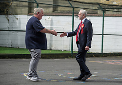 © Licensed to London News Pictures. 08/06/2017. London, UK. Leader of the Labour Party JEREMY CORBYN is greeted by a constituent before voting at a polling station at a school in his constituency of Islington North in London. Earlier this year British prime minister Theresa may Prime Minister Theresa May received the necessary two-thirds majority vote in parliament to call a snap election. Photo credit: Ben Cawthra/LNP