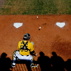 Mar 13, 2013; Bradenton, FL, USA; Fans watch from overhead as Pittsburgh Pirates catcher Russell Martin (55) practice blocking wild pitches in the bullpen before a spring training game against the Toronto Blue Jays at McKechnie Field. Mandatory Credit: Derick E. Hingle-USA TODAY Sports