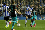 Arsenal forward Joel Campbell and Sheffield Wednesday midfielder Jeremy Helan compete for the ball during the Capital One Cup Fourth Round match between Sheffield Wednesday and Arsenal at Hillsborough, Sheffield, England on 27 October 2015. Photo by Aaron Lupton.