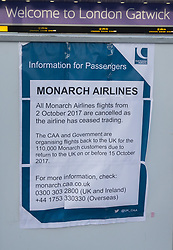 © Licensed to London News Pictures. 02/10/2017. Crawley, UK. A poster at Gatwick Airport announces that Monarch Airlines has ceased trading. The government has announced that it will start the country's biggest ever peacetime repatriation to fly about 110,000 stranded passengers home. Photo credit: Peter Macdiarmid/LNP