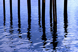 Stock photo of an abstract view of poles and their reflections