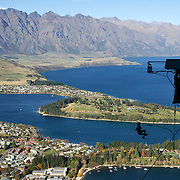 A participant jumps from the famous AJ Hackett Bungy Jump ' The Ledge' above Queenstown, New Zealand. The Bungy jump comes equipped with a runway to launch out 400 metres over Queenstown. with the Remarkables Mountain Range providing a stunning backdrop. Queenstown, Central Otago, South Island, New Zealand. 11th May 2011. Photo Tim Clayton..