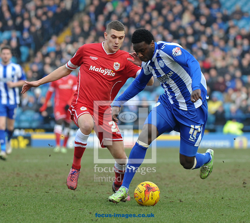 Jeremy Helan of Sheffield Wednesday and Stuart O'Keefe of Cardiff City during the Sky Bet Championship match at Hillsborough, Sheffield<br /> Picture by Richard Land/Focus Images Ltd +44 7713 507003<br /> 07/02/2015