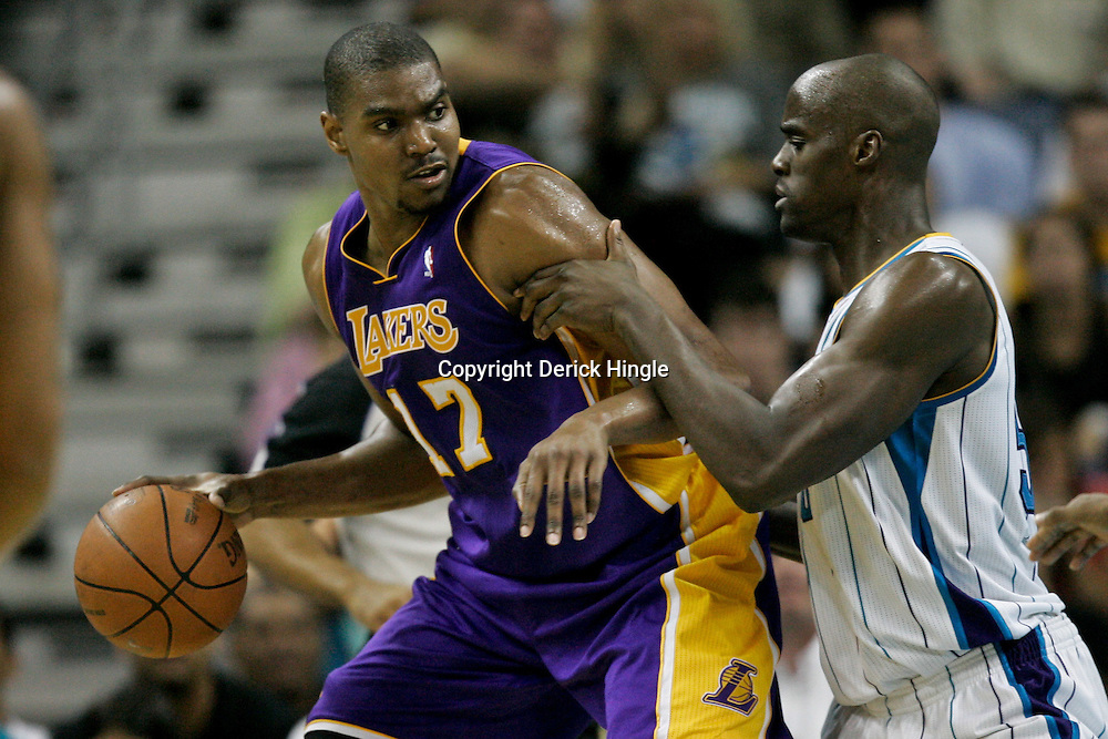 April 24, 2011; New Orleans, LA, USA; Los Angeles Lakers center Andrew Bynum (17) is defended by New Orleans Hornets center Emeka Okafor (50) during the third quarter in game four of the first round of the 2011 NBA playoffs at the New Orleans Arena. The Hornets defeated the Lakers 93-88.   Mandatory Credit: Derick E. Hingle