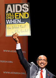 © Licensed to London News Pictures. 20/07/2014. Executive Director of UNAIDS Michel Sidibé raises a placard reading 'Aids will only end when the Global Fund is Fully Funded during the official opening ceremony of the 20th International AIDS conference held in Melbourne Australia on July 20, 2014. This conference takes place a few days after the death of a number of high profile delegates and researchers due to attend whom flew on Malaysian Airlines flight MH17. Photo credit : Asanka Brendon Ratnayake/LNP