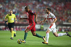 October 10, 2017 - Lisbon, Portugal - Portugal's midfielder Joao Mario (C ) vies with Switzerland's forward Admir Mehmedi (R ) during the 2018 FIFA World Cup qualifying football match between Portugal and Switzerland at the Luz stadium in Lisbon, Portugal on October 10, 2017. Photo: Pedro Fiuza  (Credit Image: © Pedro Fiuza/NurPhoto via ZUMA Press)