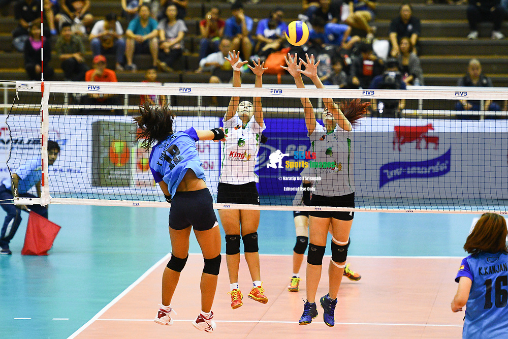 BANGKOK, THAILAND - MARCH 24: Chutimon Sagorn #6 and Siriporn Sooksen #4 of King-Bangkok VC going for the block at the net during the 2017 Women's Volleyball Thai-Denmark Super League, MCC Hall The Mall , Bangkok, Thailand on March 24, 2017.<br /> .<br /> .<br /> .<br /> (Photo by: Naratip Golf Srisupab/SEALs Sports Images)<br /> .<br /> Any image use must include a mandatory credit line adjacent to the content which should read: Naratip Golf Srisupab/SEALs Sports Images