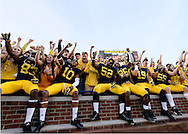 Oct 10, 2015; Ann Arbor, MI, USA; Michigan Wolverines players celebrate in the student section after the game against the Northwestern Wildcats at Michigan Stadium. Michigan won 38-0. Mandatory Credit: Rick Osentoski-USA TODAY Sports