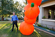 26 OCTOBER 2010 - PHOENIX, AZ: Terry Goddard inflates a Halloween decoration in their front yard in central Phoenix.  Goddard lost the election to sitting Governor Jan Brewer, a conservative Republican.     PHOTO BY JACK KURTZ