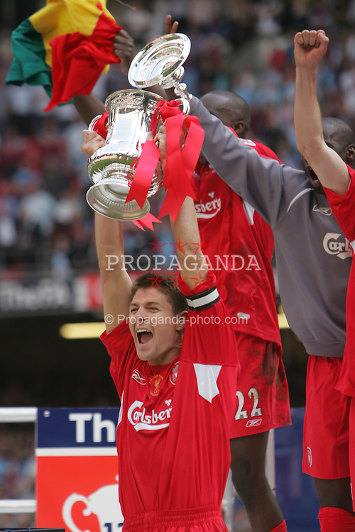 CARDIFF, WALES - SATURDAY, MAY 13th, 2006: Liverpool's captain Steven Gerrard lifts the FA Cup after beating West Ham United on penalties during the FA Cup Final at the Millennium Stadium. (Pic by David Davies/Pool/Propaganda)