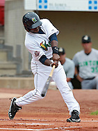 Kernels second baseman Kevin Moesquit (12) connects on a pitch during the game between the Clinton LumberKings and the Cedar Rapids Kernels at Veterans Memorial Stadium in Cedar Rapids on Monday, September 3, 2012.