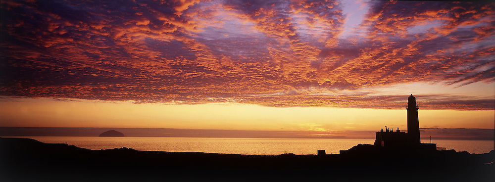 Glorious summer sunset as the famous Lighthouse and Ailsa Craig are lit up at Turnberry - Ailsa Course,Turnberry,Ayrshire,Scotland.