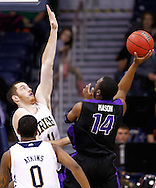 SOUTH BEND, IN - DECEMBER 21: Garrick Sherman #11 of the Notre Dame Fighting Irish defends the shot of Antoine Mason #14 of the Niagara Purple Eagles at Purcel Pavilion on December 21, 2012 in South Bend, Indiana. (Photo by Michael Hickey/Getty Images) *** Local Caption *** Garrick Sherman; Antoine Mason
