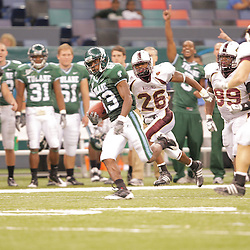 20 September 2008: Tulane wide receiver Brian King (83) converts on a fake fake punt as Louisiana-Monroe defenders Nate Brown (26), Aaron Williams (99) and Chance Payne (13) during a Conference USA match up between the University of Louisiana Monroe and Tulane at the Louisiana Superdome in New Orleans, LA.