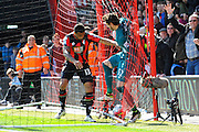 AFC Bournemouth forward Callum Wilson and Liverpool goalkeeper Danny Ward push and shove each other in the goal nets after Bournemouth score during the Barclays Premier League match between Bournemouth and Liverpool at the Goldsands Stadium, Bournemouth, England on 17 April 2016. Photo by Graham Hunt.