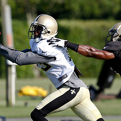 July 29, 2012; Metairie, LA, USA; New Orleans Saints wide receiver Courtney Roby (15) makes a catch over cornerback Kamaa, Mcllwain (25) during a training camp practice at the team's practice facility. Mandatory Credit: Derick E. Hingle-US PRESSWIRE