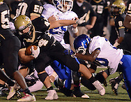 LEVITTOWN, PA - OCTOBER 31: Truman's Trysten Hunt rushes with the football as Norristown defenders tackle him in the first quarter at Harry S. Truman high school  October 31, 2014 in Levittown, Pennsylvania. (Photo by William Thomas Cain/Cain Images)