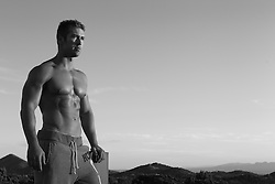 shirtless athletic man outdoors in sweatpants
