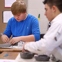 Adam Robison | BUY AT PHOTOS.DJOURNAL.COM<br /> Zac Taylor, a tenth grader at Ripley High School, works on his catfish themed ceramic pot in his Art 2 class as he and his classmates work on their artist of the week project Monday in Ripley. This weeks artist is Mississippi native and American Ceramic Artist George Edgar Ohr and the project is called the Ohr project. Each student in the class is creating a ceramic pot inspired by Ohr.