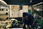 A man sets up his food stall at Napoli NYE Tek, a New Year's Eve party in Naples, Italy, December 2014