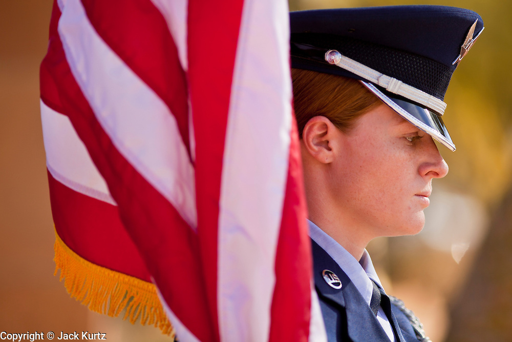 09 DECEMBER 2011 - PHOENIX, AZ:  A US Air Force enlisted person carries the American flag during a wreath laying ceremony in Phoenix Saturday. Several hundred volunteers and veterans gathered at the National Memorial Cemetery of Arizona in Phoenix Saturday to lay Christmas wreaths on headstones, a tradition started by Wreaths Across America. Wreaths Across America is a nonprofit organization founded to continue and expand the annual wreath laying ceremony at Arlington National Cemetery begun by Maine businessman, Morrill Worcester, in 1992.   PHOTO BY JACK KURTZ