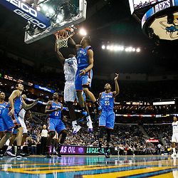 January 24,  2011; New Orleans, LA, USA; New Orleans Hornets center Emeka Okafor (50) dunks over Oklahoma City Thunder point guard Russell Westbrook (0) during the first half at the New Orleans Arena. The Hornets defeated the Thunder 91-89. Mandatory Credit: Derick E. Hingle