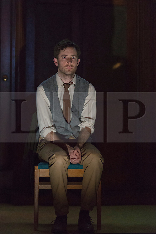 """© Licensed to London News Pictures. 08/05/2014. London, England. Pictured: Sam Crane as Winston. The Play """"1984"""" by George Orwell transfers to the Playhouse Theatre until 19 July 2014. A new adaptation for the stage by Robert Icke and Duncan MacMillan. With Sam Crane as Winston Smith. Photo credit: Bettina Strenske/LNP"""