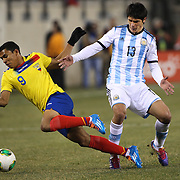 Jefferson Montero, (left),  Ecuador, is challenged by  Facundo Roncaglia, Argentina, during the Argentina Vs Ecuador International friendly football match at MetLife Stadium, New Jersey. USA. 15th November 2013. Photo Tim Clayton