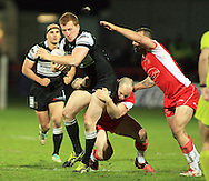 Jordan Thompson (left) of Hull Football Club is tackled by Rhys Lovegrove &amp; Josh Hodgson of Hull Kingstone Rovers during the First Utility Super League match at Craven Park, Hull<br /> Picture by Richard Gould/Focus Images Ltd +44 7855 403186<br /> 17/04/2014