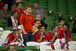 DUBLIN, REPUBLIC OF IRELAND - Wednesday, May 25, 2011: Wales' travelling supporters look dejected after their side's 3-1 defeat to Scotland during the Carling Nations Cup match at the Aviva Stadium (Lansdowne Road). (Photo by David Rawcliffe/Propaganda)
