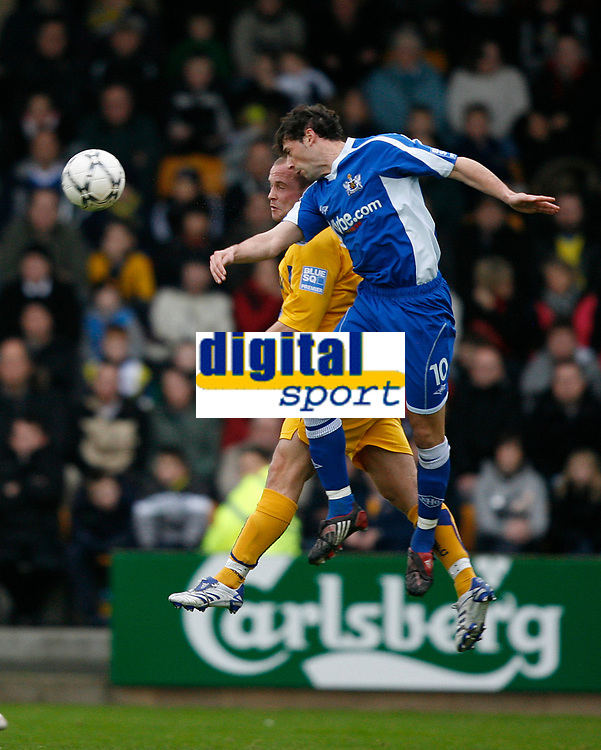 Photo: Steve Bond/Sportsbeat Images.<br />Torquay United v Exeter City. The FA Blue Square Premier. 01/01/2008. Wayne Carlisle (front) beats Kevin Nicholson in the air