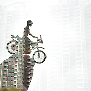 Short Ride, Hong Kong by Sinna Hermanto.<br /> <br /> A double exposure image showing a toy figure on a motorbike, against the backdrop of skyscrapers in Hong Kong. <br /> <br /> Sinna Hermanto is an Indonesian female photographer from Ponorogo, East Java, a city known for its traditional dance Reog Ponorogo. From 2003 to 2016, she lived in Hong Kong as a domestic helper, and she has recently moved back to Indonesia. In her spare time, she uses photography and writing to speak up about the social issues she cares about.