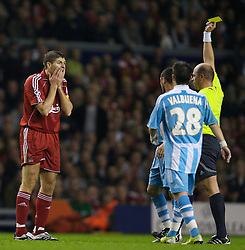 Liverpool, England - Wednesday, October 3, 2007: Liverpool's Steven Gerrard MBE looks shocked as he is shown the yellow card by referee Konrad Plautz against Olympique de Marseille during the UEFA Champions League Group A match at Anfield. (Photo by David Rawcliffe/Propaganda)