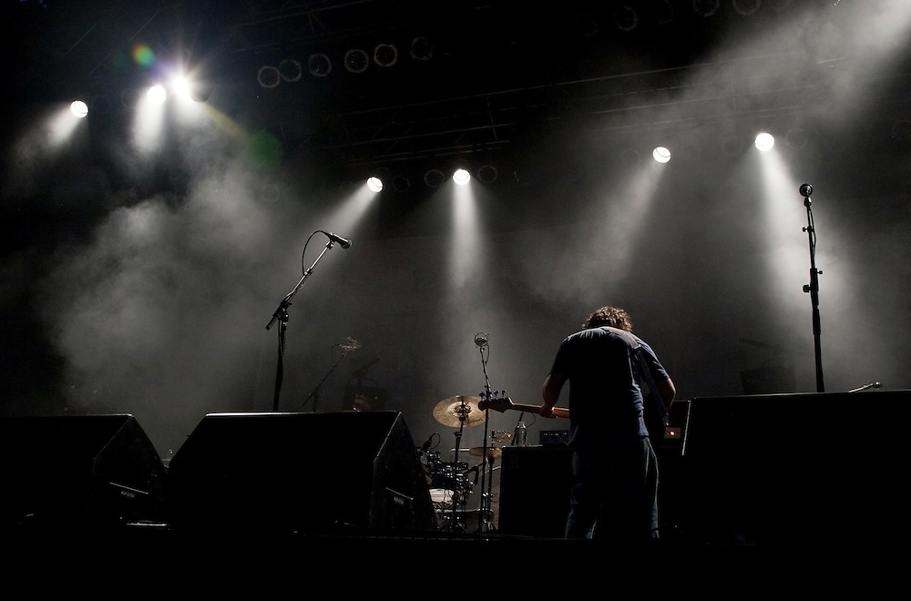 A roadie checks rock band WIlco's setup just prior to their Saturday night headlining performance during the Solid Sound Festival, Wilco's inaugural music festival, at the Massachussetts Museum of Contemporary Art. Over 5,000 people attended the three-day festival in the Berkshires, which featured music, art, comedy, and more.