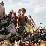 Cambodian children and others search for items June 15, 2006, that can be salvaged and resold at the dump on the outskirts of Phnom Penh, Cambodia.