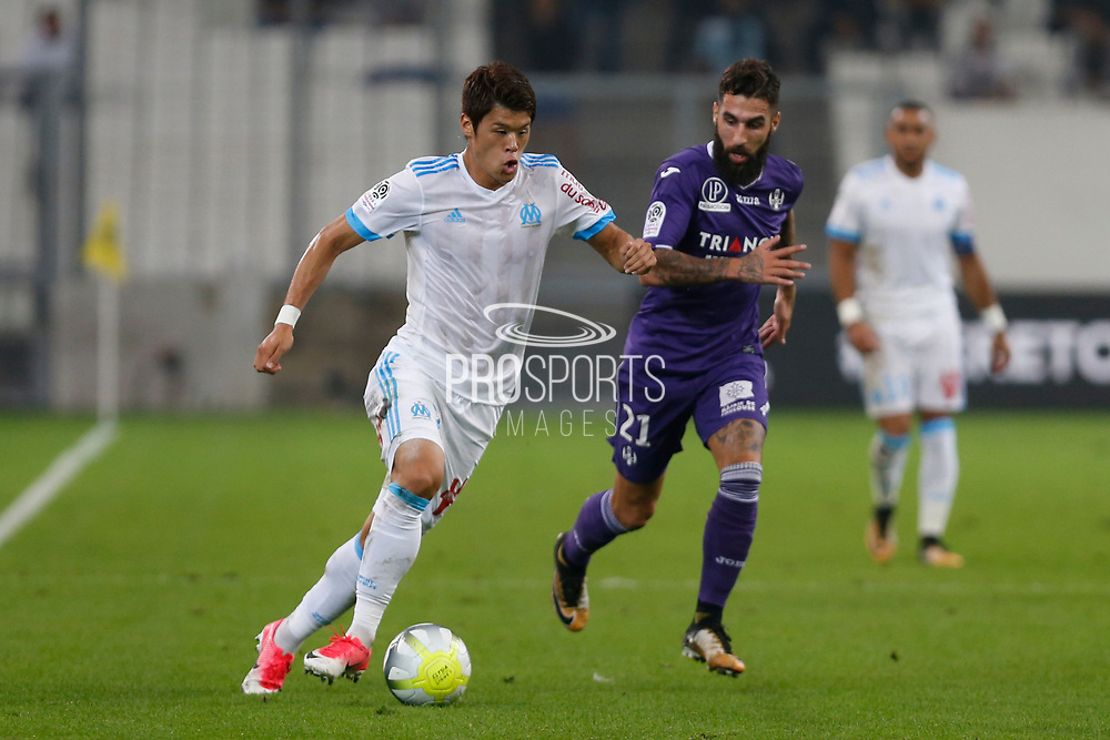 Hiroki Sakai of OM and Jimmy Durmaz of TFC during the French Championship Ligue 1 football match between Olympique de Marseille and Toulouse FC on September 24, 2017 at Orange Velodrome stadium in Marseille, France - Photo Philippe Laurenson / ProSportsImages / DPPI
