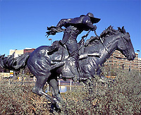 Cast Iron Sculpture of Cowboy on horse in Dallas