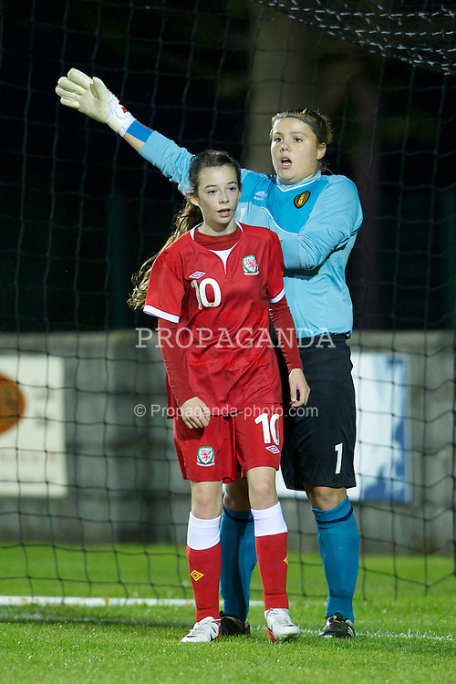 PORTHMADOG, WALES - Monday, October 1, 2012: Wales' Kelsey Davies in action against Belgium's goalkeeper Justien Odeurs during the International Friendly Under-16's match at y Traeth. (Pic by David Rawcliffe/Propaganda)