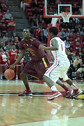 11 January 2014:  Milton Doyle dribbles near half court guarded by Paris Lee during an NCAA  mens basketball game between the Ramblers of Loyola University and the Illinois State Redbirds  in Redbird Arena, Normal IL.  Redbirds win 59-50
