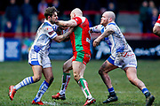 Workington Town scrum half Carl Forber (7) and Workington Town prop Stevie Scholey (10)  tackle Keighley Cougars centre Adam Ryder (4)  during the Betfred League 1 match between Keighley Cougars and Workington Town at Cougar Park, Keighley, United Kingdom on 18 February 2018. Picture by Simon Davies.