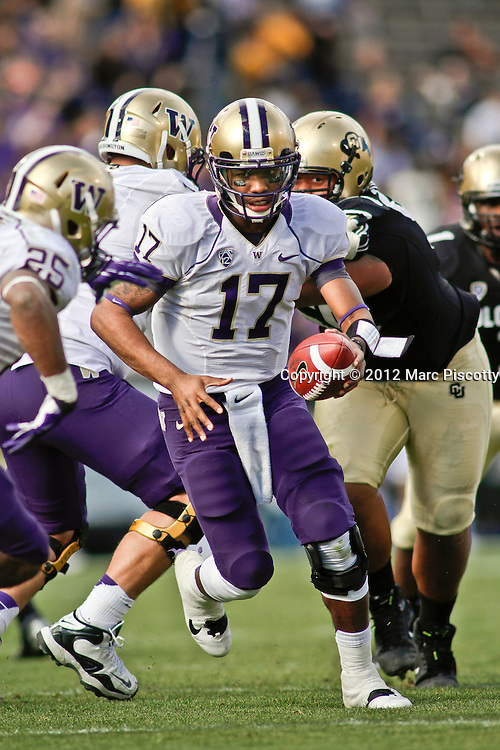 SHOT 11/17/12 2:21:01 PM - Washington quarterback Keith Price #17 looks to hand off against Colorado during their Pac-12 regular season game at Folsom Field in Boulder, Co. Washington won the game 38-3. (Photo by Marc Piscotty / © 2012)