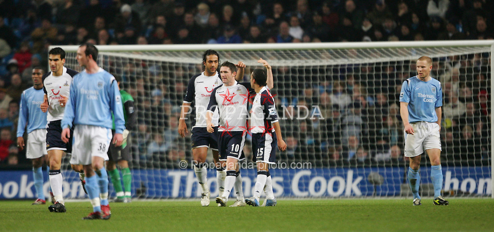 MANCHESTER, ENGLAND - WEDNESDAY, JANUARY 4th, 2006: Tottenham Hotspur's Mido (L) celebrates scoring the opening goal against Manchester City with his team-mates during the Premiership match at the City of Manchester Stadium. (Pic by David Rawcliffe/Propaganda)