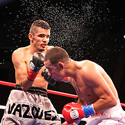 Miguel Vazquez  (Left) and Marvin Quintero fight for the IBF Lightweight title during the HBO Triple Explosion fight at the Turning Stone Resort Casino in Verona, NY, on Saturday, Oct 27, 2012. (AP Photo/Alex Menendez)