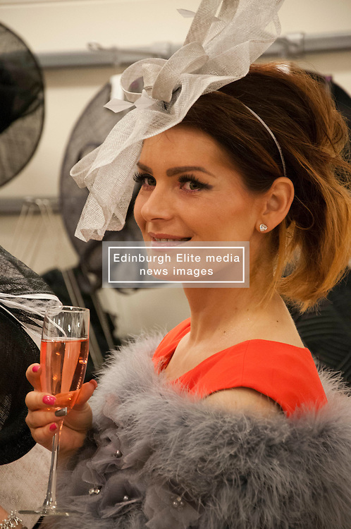 Kate Podles joins the ladies as they line up at Allure Medi Spa in Debenhams at Ocean Terminal to get ready for Ladies Day at Musselburgh Race Course. 11 June 2012 (Ger Harley | StockPix).