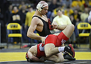 January 22 2010: Iowa's Matt Ballweg works on Ohio State's Mike Fee during the 149-pound bout an NCAA wrestling dual at Carver-Hawkeye Arena in Iowa City, Iowa on January 22, 2010. Ballweg defeated Fee in a major decision 12-3 and Iowa defeated Ohio State 33-3..