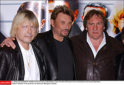 File photo : © Serge Arnal/ABACA. 44098-14. Paris-France, 29/03/2003. Cast members Renaud Sechan, Johnny Hallyday and Gerard Depardieu attend Wanted film premiere at Gaumont Marignan theater. France's biggest rock star Johnny Hallyday has died from lung cancer, his wife says. He was 74. The singer - real name Jean-Philippe Smet - sold about 100 million records and starred in a number of films. Photo by Serge Arna/ABACAPRESS.COM